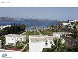 Ortakent Bagla koyunda denize sıfır ,ozel plajlı sitede villa