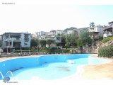 Damping- Türkbükü'nde denize yakın sitede satılık müstakil villa